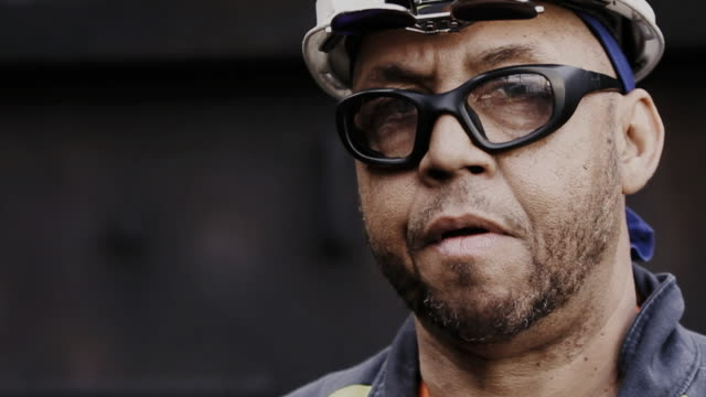 Portrait of African American blue collar industrial worker