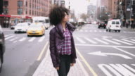 Portrait of Afro American Female standing in street