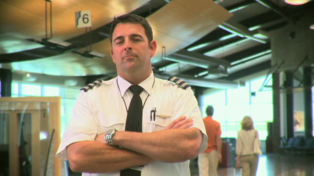 MS Portrait of airline pilot in terminal, Appleton, Wisconsin, USA