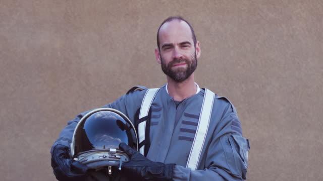 Portrait of astronaut holding helmet