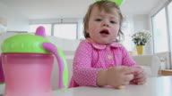 MS Portrait of baby girl (12-23 months) sitting at table / Jersey City, New Jersey, USA