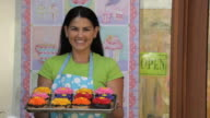 MS Portrait of Bakery Owner Holding Tray of Cupcakes / Richmond, Virginia, USA