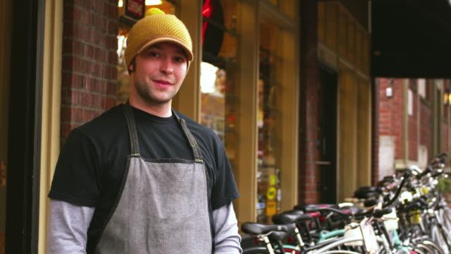 MS Portrait of bike shop owner in front of shop / Portland, Oregon, USA