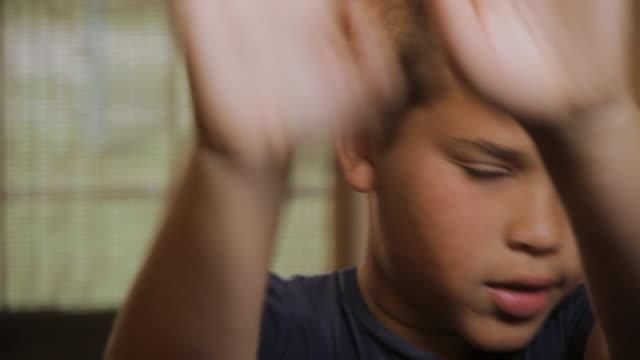 CU Portrait of boy (10 -11) showing 'no way' gesture / Madison, Florida, USA