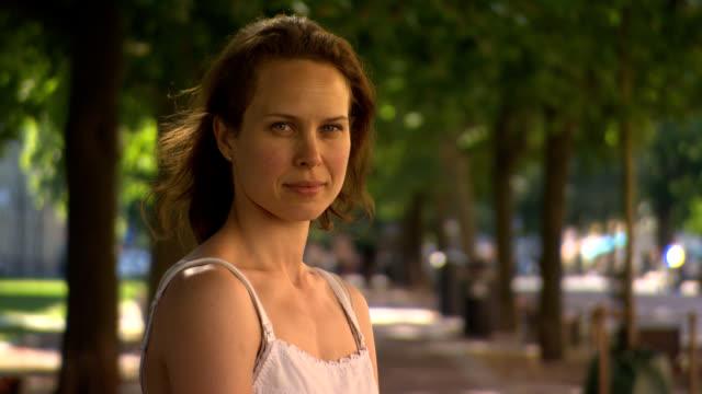 Portrait of brunette woman face outdoor summertime