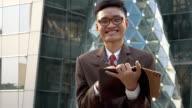 Portrait of business man in modern city