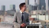 Portrait of businessman with London city skyline