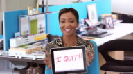 MS Portrait of Businesswoman Holding Tablet Computer with the Message 'I Quit!!' / Richmond, Virginia, USA