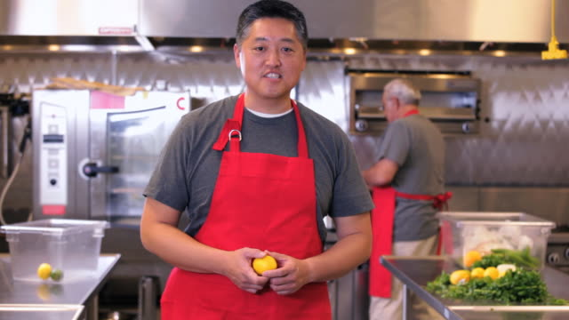 MS Portrait of Chef in Commercial Kitchen Speaking to Camera / Richmond, Virginia, USA