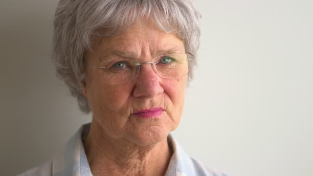 Portrait of concerned old woman