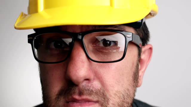 Portrait of construction worker on white background