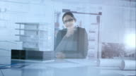 Portrait of female architect through her office glass wall