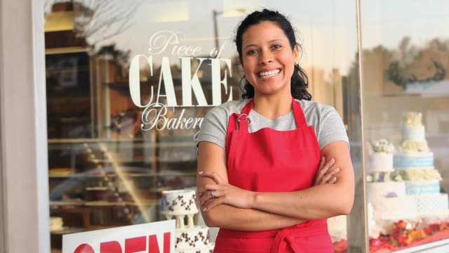 MS TU Portrait of female baker standing outside bakery / Richmond, Virginia, USA