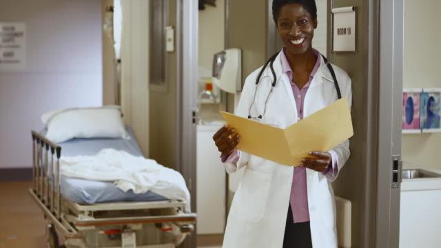 MS Portrait of female doctor in hospital hallway / Edmonds, Washington, USA