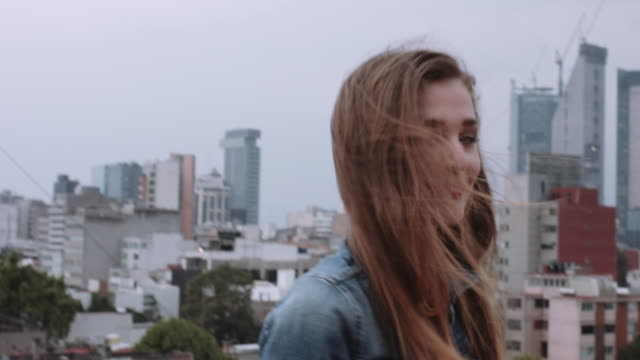 Portrait of female on rooftop with skyline