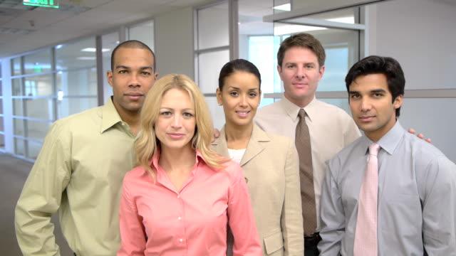 Portrait of five coworkers in office