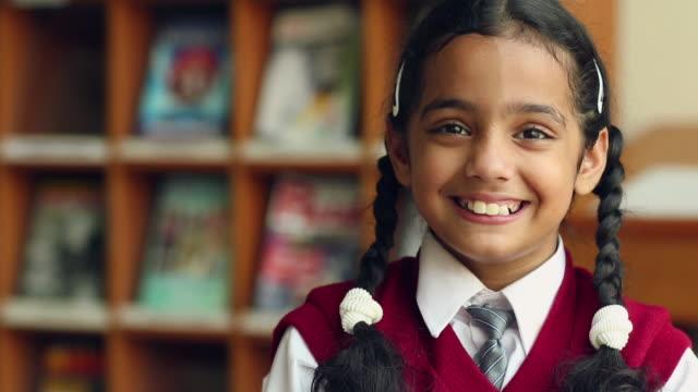 Portrait of group of school students smiling, Noida, Uttar Pradesh, India