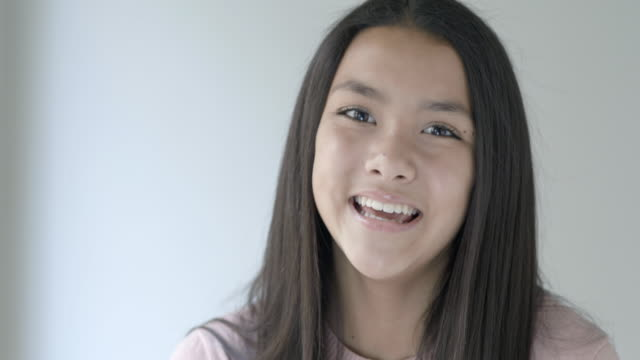 Portrait of happy preteen girl smiling to camera