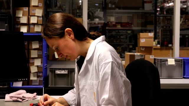 Portrait Of Happy Technician Working At Desk