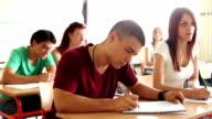 Portrait of high school student at desk