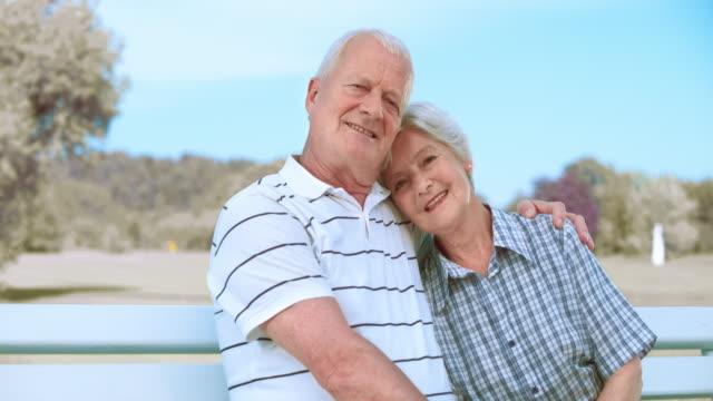 SLO MO Portrait of loving senior couple in the park