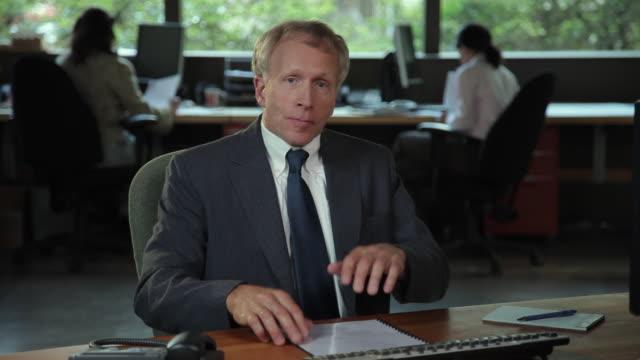 MS Portrait of male executive at desk / Portland, Oregon, USA