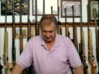 MS, Portrait of man in gun shop, Tonopah, Nevada, USA