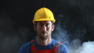 Portrait of Manual Worker In Dark And Fog