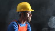 Portrait of Manual Worker Smoking In Dark
