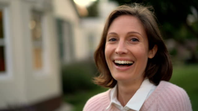 Portrait of mid adult woman smiling in yard