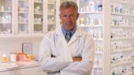 MS PAN Portrait of Pharmacist Behind Pharmacy Counter / Richmond, Virginia, USA