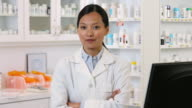 MS Portrait of Pharmacist Behind Pharmacy Counter / Richmond, Virginia, USA