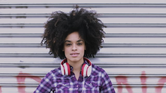Portrait of pretty Afro American Female on street looking to camera