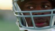 CU R/F Portrait of professional football player wearing helmet