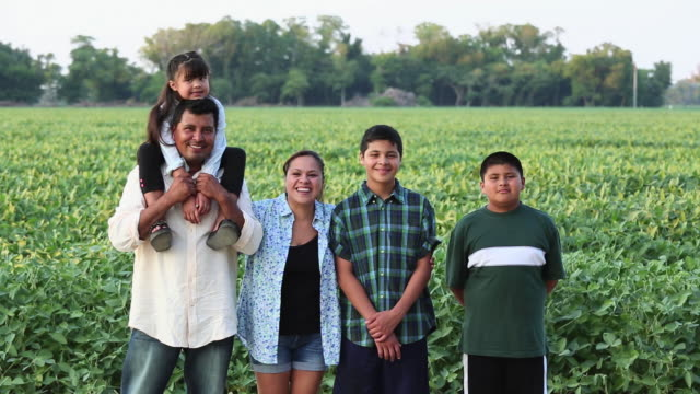 WS DS Portrait of Proud Family Standing in Field of Crops / Eastville, Virginia, United States