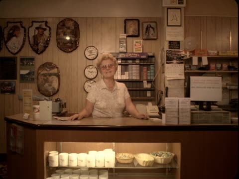 MS, Portrait of senior hostess at reception desk, Reno, Nevada, USA
