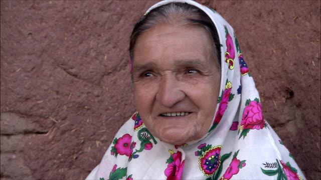 CU Portrait of senior woman wearing traditional headscarf, Abyaneh, Iran