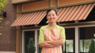 MS Portrait of Small Business Owner in Front of Shop in Suburban Shopping Center / Richmond, Virginia, USA