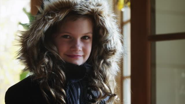 CU Portrait of smiling girl (8-9) wearing warm jacket with fur hood / Cedar Hills, Utah, USA