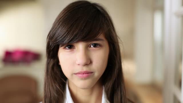 CU Portrait of smiling teenage girl (14-15) with braced teeth / Brussels, Brabant, Belgium