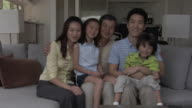 MS, ZI, Portrait of three generation family with son (4-5) and daughter (6-7) sitting on sofa