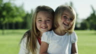 MS Portrait of two girls (4-5, 10-11) in park / Orem, Utah, USA
