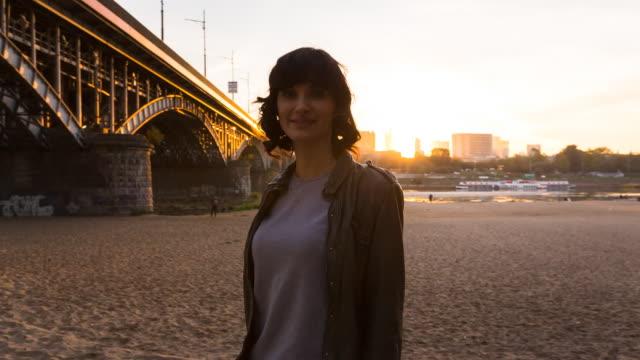 MS Portrait of woman eat city beach at sunset