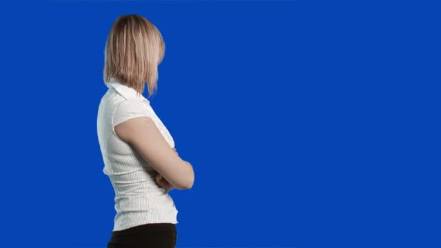 MS Portrait of woman on blue screen
