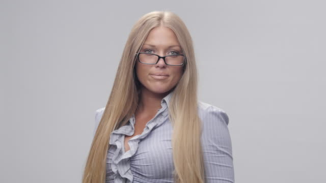 Portrait of Young, Blond, Cheerful Woman Trying New Glasses And Making Faces