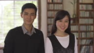 CU portrait of young couple at home