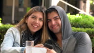 Portrait of young couple in outdoor cafe