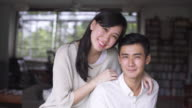 CU portrait of young couple smiling and hugging each other