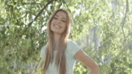 Portrait of young happy woman in park