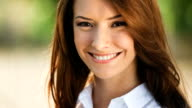 HD(720p30): Portrait of young happy woman outdoors